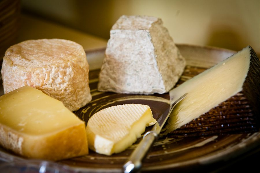 five local cheeses on a plate.