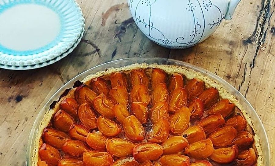 Apricot tarte on wooden table.