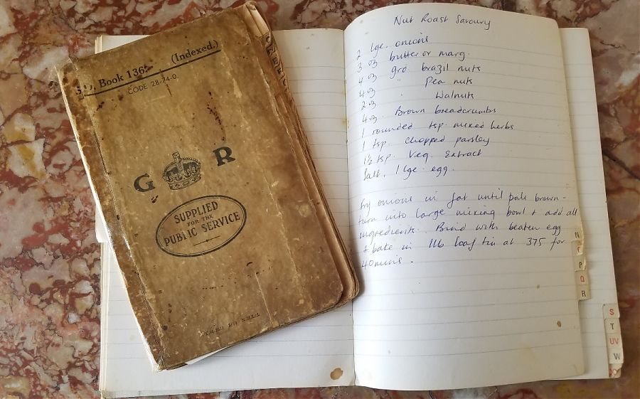 Recipe book and lined paper with nut roast recipe