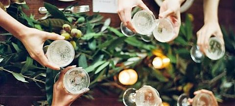 People holding glasses of sparkling wine.